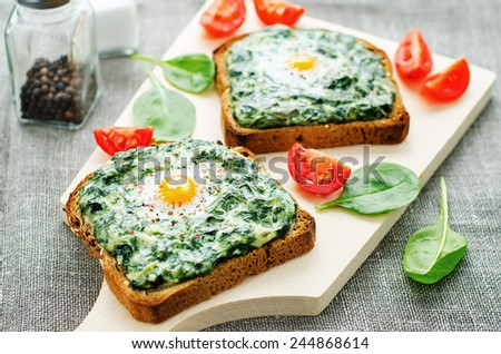 sandwich baked with spinach, cream cheese and egg. tinting. selective focus - stock photo