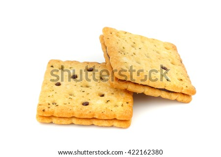 Sandwich biscuits filled with chocolate cream, isolated on white background  - stock photo