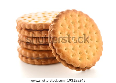 Sandwich biscuits with vanilla filling on a white background - stock photo