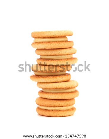 Sandwich biscuits with white cream. Isolated on a white background.