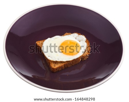 sandwich from fried egg and toast on plate isolated on white background - stock photo