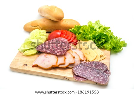 Sandwich ingredients on a wooden board against white background - stock photo