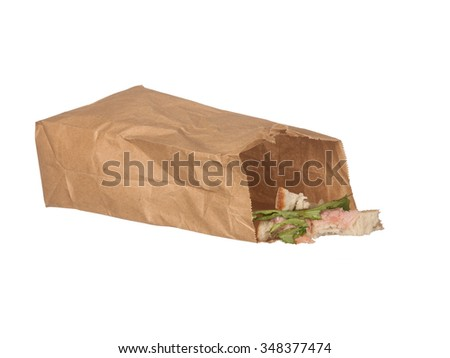 Sandwich left-overs in brown paper bag isolated on white background