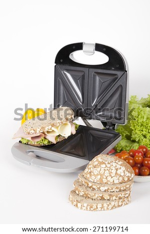 sandwich maker gray with food