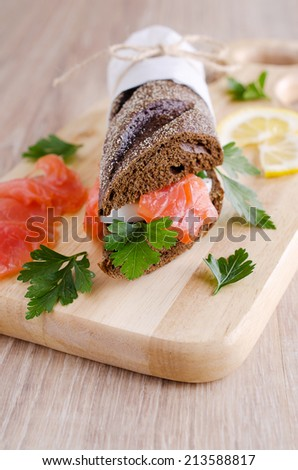 Sandwich of salted salmon and eggs on rye bread
