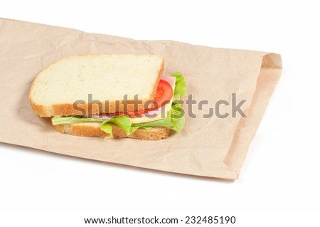 Sandwich on a paper bag isolated on white