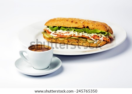 Sandwich on plate and cup of coffee on white background - stock photo
