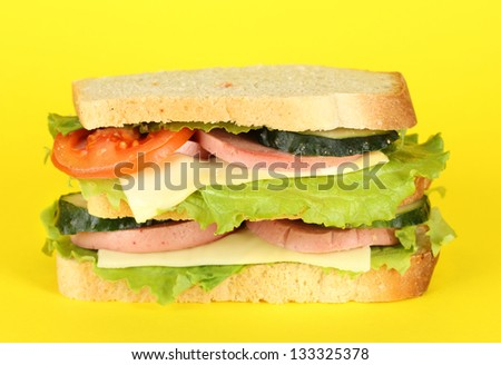 Sandwich on yellow background