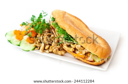 Sandwich prepared with kebab curry chicken meat, baguette and fresh vegetables: cucumber, carrots, parsley and tomato. Healthy, tasty food. Restaurant, menu, snack, lunch time, lunch. - stock photo