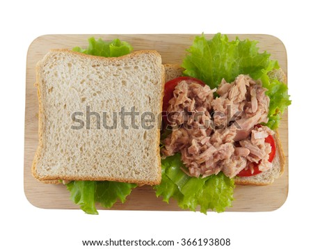 sandwich tuna fresh on wooden plate top view of isolated, with copy space - stock photo