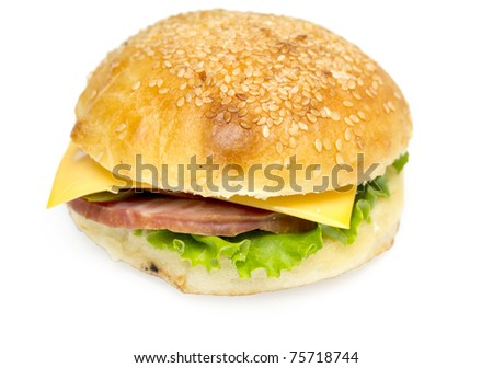 Sandwich with a ham, paprika and cheese isolated on a white background