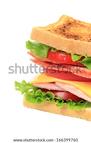 Sandwich with bacon and vegetables. Whole background.