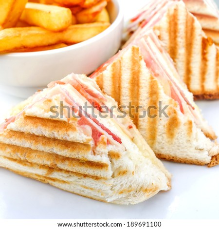 Sandwich with bacon - chicken, cheese and golden French fries potatoes