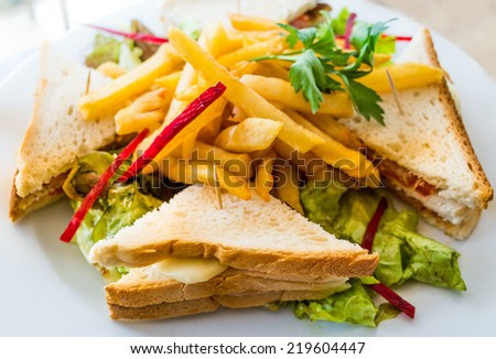 Sandwich with bacon - chicken, cheese and lettuce