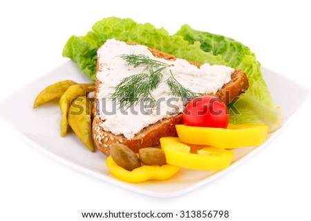 Sandwich with cheese and dill, fresh vegetables on plate. - stock photo