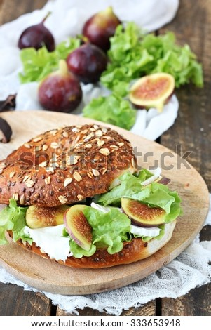 Sandwich with cheese , lettuce , fig and honey