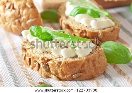 sandwich with cream cheese, basil and green garlic - stock photo