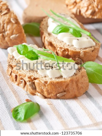 sandwich with cream cheese, basil and green garlic