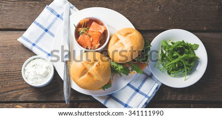 Sandwich with cream cheese salmon and arugula - stock photo
