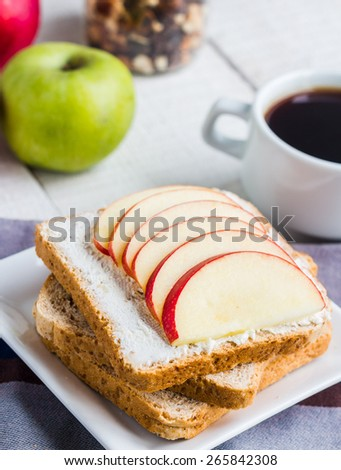 sandwich with curd cheese, apple, honey and dried fruits, coffee, healthy breakfast, white background - stock photo
