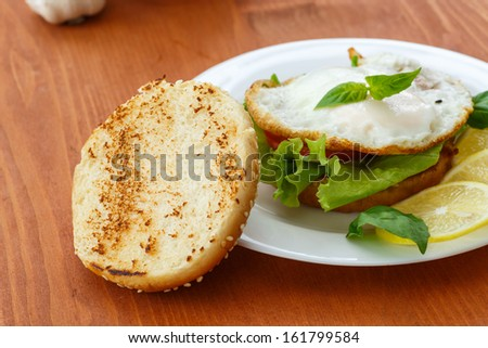 sandwich with egg and vegetables on a wooden table