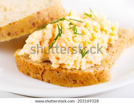 sandwich with egg salad on a plate - stock photo