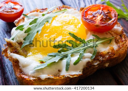 Sandwich with egg tomato and arugula - stock photo