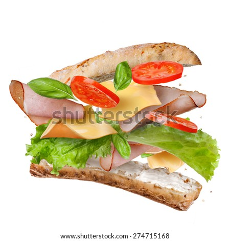 Sandwich with falling ingredients in the air isolated on white - slices of fresh tomatoes, ham, cheese and lettuce - stock photo