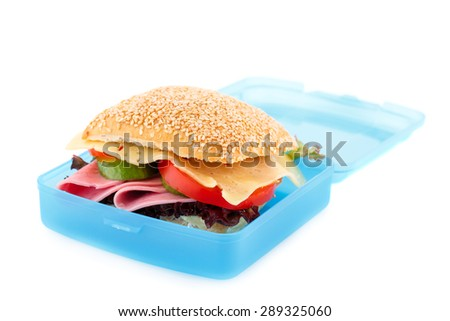 Sandwich with fresh vegetables, ham and cheese in plastic container isolated on white background. - stock photo
