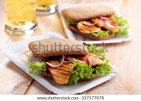 Sandwich with grilled chicken and beer - stock photo