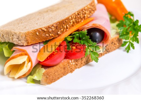 sandwich with grilled vegetables and chicken in white background