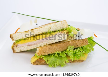 sandwich with ham and cheese, decorated eggs