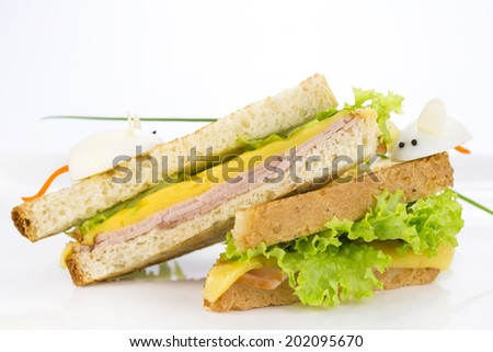 sandwich with ham and cheese, decorated eggs - stock photo