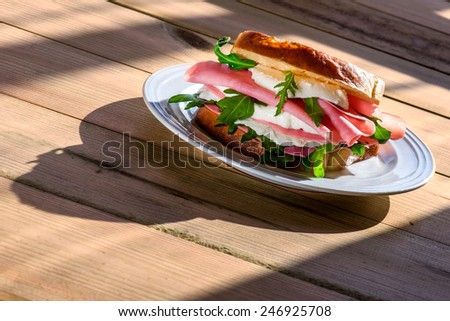 sandwich with ham and cheese in wooden table - stock photo
