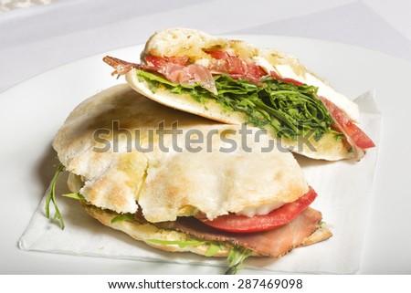 Sandwich with ham and fresh salad - stock photo