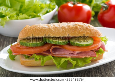 sandwich with ham and fresh vegetables, close-up - stock photo