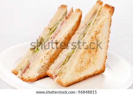 sandwich with ham and vegetables - stock photo