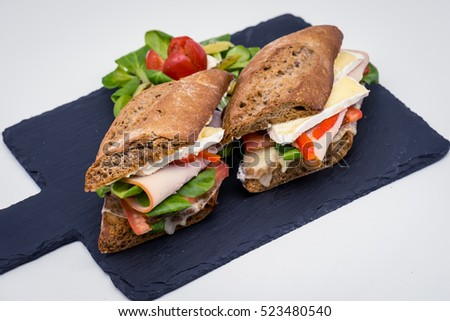 sandwich with ham, brie cheese, vegetables