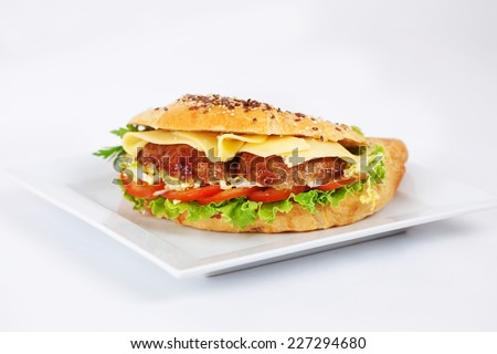 Sandwich with ham, cheese, peppers on a white background - stock photo