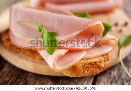 Sandwich with ham close up. Food background - stock photo
