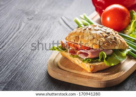 Sandwich with ham, tomatoe and radish - stock photo