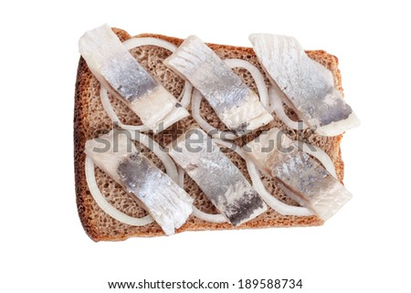 sandwich with herring and onions - stock photo
