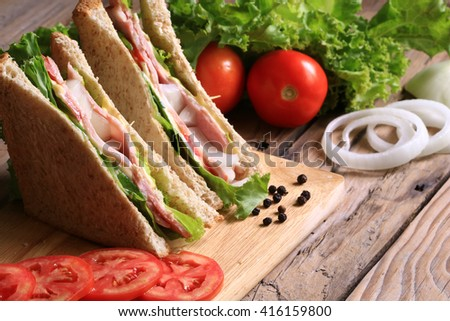 Sandwich with Lettuce, Tomato, bacon and Onion - stock photo