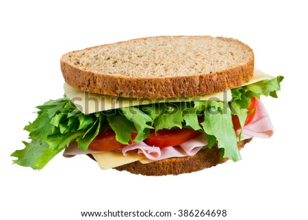 Sandwich with lettuce, tomato, ham and cheese  isolated on white - stock photo