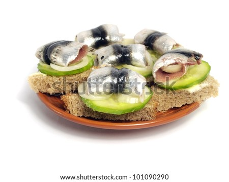 sandwich with marinated sprat on a white background