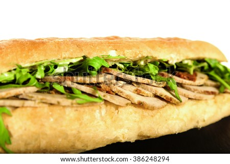 Sandwich with Meat Pork on Granite Chopping Board Plate with Ingredient Lettuce Green Salad on White Background. Close Up of Chicken or Beef, Gyros Slice Meat and Vegetables. Delicious Healthy Meal - stock photo