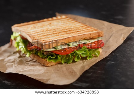 Sandwich with meat, tomato and cucumber
