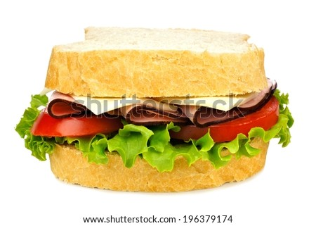 Sandwich with meat, tomato, lettuce and cheese isolated on white