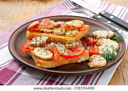 Sandwich with mushrooms and tomatoes - stock photo