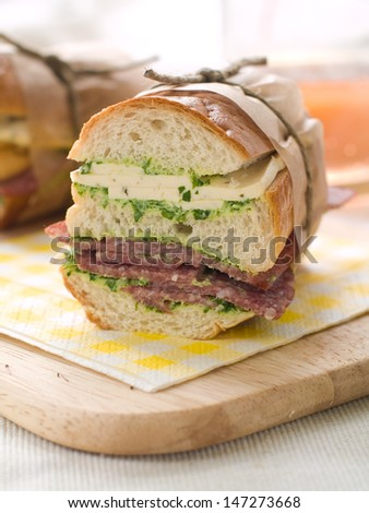 Sandwich with pesto, cheese and sausage,  selective focus